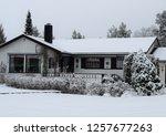 wonderful white house in snowy... | Shutterstock . vector #1257677263