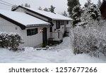 wonderful white house in snowy... | Shutterstock . vector #1257677266