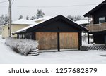 black wooden garage with two... | Shutterstock . vector #1257682879