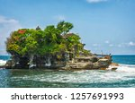tanah lot temple is one of bali'... | Shutterstock . vector #1257691993