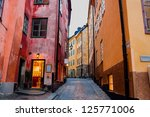 A Narrow Cobbled Street And...