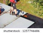 waterproofing flat roof with... | Shutterstock . vector #1257746686
