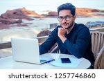 handsome and successful indian... | Shutterstock . vector #1257746860