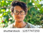 handsome and young indian male... | Shutterstock . vector #1257747253