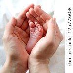 mother holding newborns baby...   Shutterstock . vector #125778608