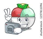 photographer scoops of sorbet...   Shutterstock .eps vector #1257811096