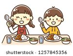 two children eating curry and...   Shutterstock .eps vector #1257845356