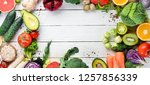 fresh vegetables and fruits on... | Shutterstock . vector #1257856339