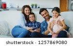 portrait of happy family having ... | Shutterstock . vector #1257869080