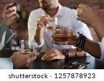 group of friends drinking... | Shutterstock . vector #1257878923