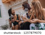 friends cheering up with... | Shutterstock . vector #1257879070