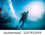 attractive surfer woman dive... | Shutterstock . vector #1257911959