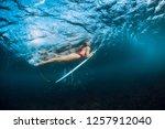 surfer girl in bikini with... | Shutterstock . vector #1257912040