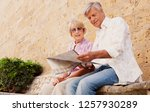 mature couple reading map... | Shutterstock . vector #1257930289