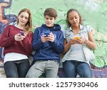 group of teenagers leaning on... | Shutterstock . vector #1257930406