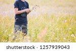 teenager boy gathering a... | Shutterstock . vector #1257939043