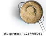raw white quinoa in a pan   Shutterstock . vector #1257955063
