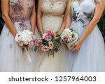 tree brides standing together... | Shutterstock . vector #1257964003