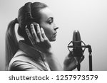 young beautiful girl records... | Shutterstock . vector #1257973579
