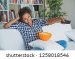 afro woman sitting at home with ... | Shutterstock . vector #1258018546