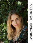 a pretty blonde  blue eyed girl  | Shutterstock . vector #1258021279