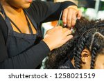 Close Up African Hairstylist...