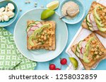 toasts with chickpea hummus ... | Shutterstock . vector #1258032859