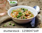 buckwheat with green peas and... | Shutterstock . vector #1258047169