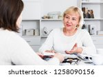 mature woman consults with a... | Shutterstock . vector #1258090156