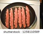 turkey bacon in frying pan   Shutterstock . vector #1258110589