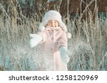 little cute smiling girl in... | Shutterstock . vector #1258120969