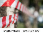 red and white striped tape... | Shutterstock . vector #1258126129
