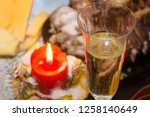 festive champagne with a candle ... | Shutterstock . vector #1258140649