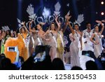 Small photo of Bangkok, Thailand - Dec 13, 2018: Miss Universe contestants walk on stage during the Miss Universe 2018 preliminary round, the final to be held in Bangkok on 17 December.