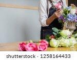woman hands making flower... | Shutterstock . vector #1258164433
