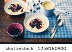 blueberries with vanilla sauce | Shutterstock . vector #1258180900