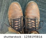 brown leather boots laced up... | Shutterstock . vector #1258195816