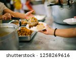 the poor are reaching for food  ... | Shutterstock . vector #1258269616