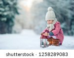 cute little girl with... | Shutterstock . vector #1258289083