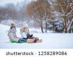 little adorable girls enjoy a... | Shutterstock . vector #1258289086