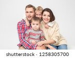 cheerful family of four on... | Shutterstock . vector #1258305700