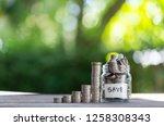savings deposit coins in a... | Shutterstock . vector #1258308343