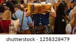 oktoberfest  munich  germany....   Shutterstock . vector #1258328479