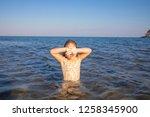 little girl with swimsuit in... | Shutterstock . vector #1258345900