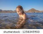 little girl sitting on the... | Shutterstock . vector #1258345903