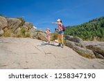 adventurous mountaineers family ... | Shutterstock . vector #1258347190