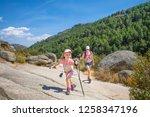 mountaineers family girl... | Shutterstock . vector #1258347196