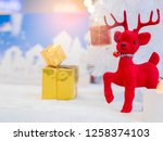 red reindeer with gift box on... | Shutterstock . vector #1258374103