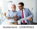 portrait of mature boss and... | Shutterstock . vector #1258390063