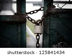 Rusty Chain And Padlock Around...